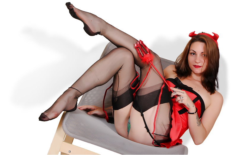 Picture of a sexy girl dressed as devil showing feet in stockings